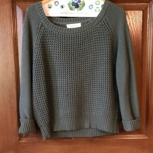 Green knitted sweater
